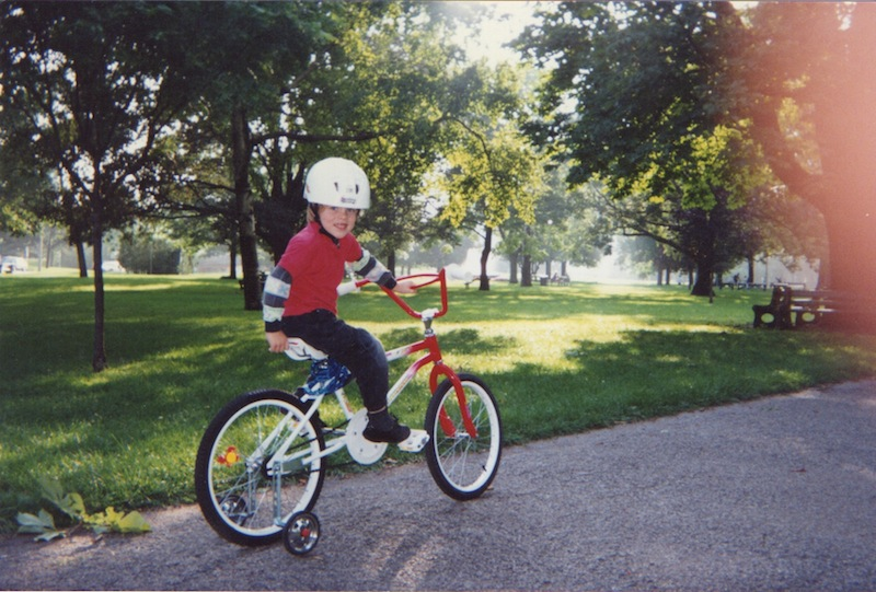 My first two-wheeler (With training-wheels, of course). This was certainly taken in Queen's Park, and it's very possible that it's my first bike ride ever!